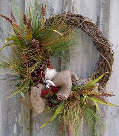 Christmas Wreath, Holiday Wreath, Woodland Décor, Elf, Pin Cones, Door Wreath. $149.00, via Etsy.  Would also work for the girl's woodland party...