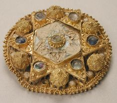 Brooch Date: Geography: Made in North Italy Culture: Ottonian Medium: Gold, pearls, glass, cloisonné enamel Dimensions: Overall: 1 x in. x cm) Classification: Metalwork-Gold Credit Line: Gift of J. Medieval Jewelry, Ancient Jewelry, Medieval Art, Antique Jewelry, Vintage Jewelry, Vintage Brooches, Ottonian, Arte Judaica, Gemstone Brooch
