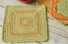 """Seeing Squares Dishcloth   This dishcloth pattern makes for a refreshing change since it is worked from the center out. Add some splashes of color for a neat geometric design! Go here to see all patterns from kitchen series.  http://www.petalstopicots.com/tag/kitchen/ Supplies: 3 colors cotton yarn, H hook.          Finished washcloth = approx 8"""" square."""
