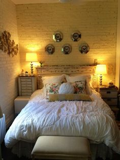 Rachel's West Village Nest via Apartment Therapy; I loe the white painted brick and mismatched nightstands