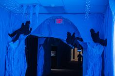 Climber silhouettes and icicles decorate an ice cave hallway at #OperationArctic #vbs2017