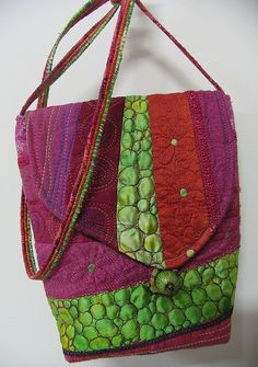 Linda Stokes: Quilted Bag    Pieced and quilted first then dyed with Napthol red. Machined cords.