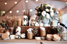 raw cotton tablescape at welcome table at rustic wedding