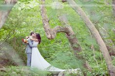 Great idea for a wider angle portrait of the bride and groom from far away... find an open spots in a forest, be sure to pull her train out!  Love this for a rustic wedding pose idea!