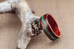Bubinga bentwood ring lined with padouk wood and malachite stone inlay