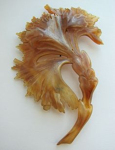 """Carved Horn French Art Nouveau Flower Pin.  During the Art Nouveau period (1885 to 1917) women wore jewelry made of carved horn. The horn was obtained from bull or mountain goats from the Jura Mountains. The horn was """"sliced, heated, bleached, carved, polished, and stained by hand."""" Lalique was the first """"master of the art."""" He was joined by Elizabeth Bonte and George Pierre, who both specialized in this art form."""