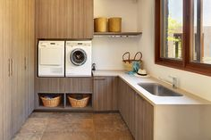Note the raised height of washer and dryer, easier on the back.  Bedfordale House - asian - Laundry Room - Other Metro - Suzanne Hunt Architect