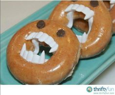 Monster doughnuts - Plastic fangs and chocolate chips make these donuts monstrously cute!