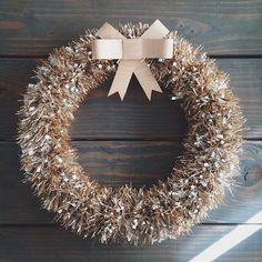 We adore this elegant tinsel Christmas wreath. For more Christmas decorating ideas visit goodhousekeeping.co.uk/christmas