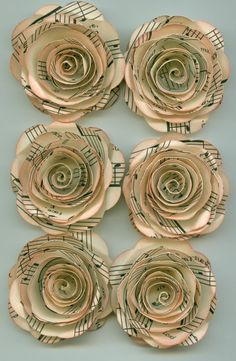 Paper flowers made from sheet music!! So pretty and elegant! I want these so my wedding  won't smell like a funeral!