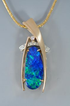 Black #opal with diamonds in yellow gold by Alex Gulko