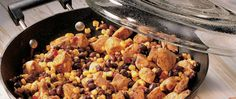 Enjoy this easy chicken, beans and corn skillet served with salsa and tortillas – a spicy dinner ready in 20 minutes.