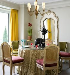 Tablecloth, cane back painted chairs, great mirror