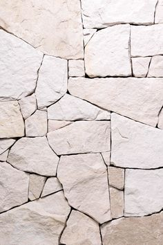 There's a wonderful 'coastal living' charm to this stone that makes it a popular choice for modern design. Its alluring off-white tone and subtle texture upon first touch creates instant appeal. Stone Decoration, Stone Interior, Tiles Texture, Stone Tile Texture, Wall Exterior, Brick And Stone, Stone Work, White Stone, Rock Wall