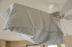 Genuis Way to Clean your Ceiling Fan ~ Simply take your pillowcase, and throw it over the blade, then use your hands to drag it back toward the edge.  As the fabric moves, the dust will fall into the pillowcase, and not on your floors (or on you!).