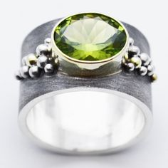 blue goldsmiths : peridot riverbed - carbon69
