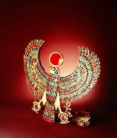 Falcon pectoral, from the Tomb of Tutankhamun, New Kingdom (gold inlaid with lapis lazuli, turquoise, carnelian & glass)