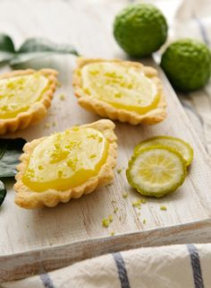 "Thai-Inspired Mini Kaffir Lime Tarts recipe - ""One touch of the kaffir lime and you'll realize how incredibly potent it is. The zest, especially, emanates with its wonderfully strong limey fragrance. Thai Dessert, Köstliche Desserts, Delicious Desserts, Dessert Recipes, Fusion Food, Lime Recipes, Sweet Recipes, Easy Recipes, Scones"