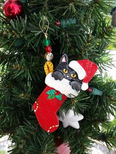 Black Cat in a Stocking Ornament ~ Kitten Cat Ornament ~Gift Box Included ~Handmade Painted Polymer Clay ~have your cats name added. by kittycatstudio on Etsy