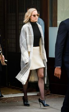 Jennifer Lawrence Departs from Her Hotel in NYC She wears Sunglasses – Oliver Peoples  Skirt – Oscar de la Renta  Shoes – Jimmy Choo
