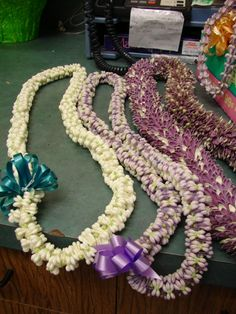double white and purple crown flower leis and petal leis