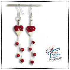 """Boucles d'oreilles """"Valentine"""" par SCHOEPFF Philippe ................................................... Collection """"St-Valentin"""". Faites en perles de Verre de Murano. Fait Main. Perles et montage par mes soins. Baguette de verre filé au chalumeau. Couleur rouge et Ivoire. Montage en Aluminium brillant pour le corps et l'attache. Longueur totale 90mm environ. Diamètre Coeur 15mm et Perles rondes environ 6 mm."""