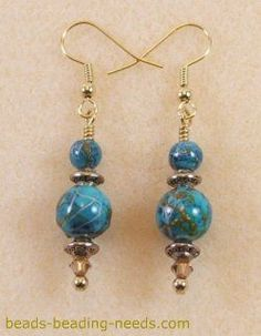 Lampwork bead earrings, these beautiful lampwork beads come together with jewelry making findings and beading instructions that make these earrings a delight to wear. #beadedjewelry #seaglassearringsideas