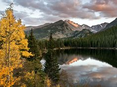 A fall evening at bear lake is rewarded with colorful aspens, clouds, and reflections. Wildlife Nature, Rocky Mountain National Park, Rocky Mountains, Nature Photography, Colorado, Waterfall, National Parks, Clouds, Sunset