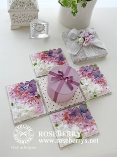 Inspiration for explosion box with surprise round box treat in centre. Floral decoration covering flaps