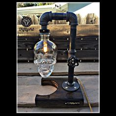Rock your home bar happy hour in steampunk style! Showcasing a reclaimed skull vodka bottle shade, this table lamp is a real showstopper for your home or office.