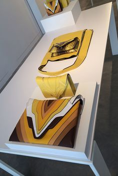 Taking cues from nature, Elena Ghisellini created a yellow-to-brown colorway representing the earth and the sun for her resort collection — which she presented against a video art installation of the bags. [Courtesy Photo]