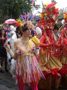 """straw lady"" costume and red painted guys...the originality of costumes at Mardi Gras never ceases to amaze me!"