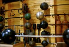 old-school gym of Kim Wood contains a collection of antique barbells and dumbbells