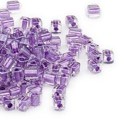Seed bead, Miyuki, glass, clear color-lined metallic violet, (SB2607), 3.5-3.7mm square. Sold per 25-gram pkg.