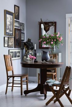 pale grey walls + pink roses. I love this wall color  who wouldn't want to have a meal or a cuppa tea here  bywstudents  love the gray background, the dark tones, the pop of flowers, and that the chair looks like somebody just got up from the table