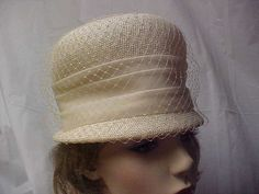Beige cloche hat with organza band and and netting covering the crown- union made- fits 21 inches