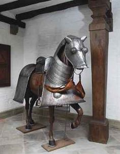 A FINE DECORATIVE FULL ARMOUR FOR A HORSE IN GERMAN EARLY 16TH CENTURY 'MAXIMILIAN' STYLE