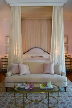 Chic luxurious soft cream and pink bedroom with canopy bed