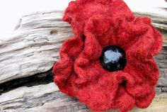 Poppies...my favorite flower. The poppy is a symbol of Morpheus, the Greek god of dreams & in Chinese symbolism, the poppy represents beauty and success. Definitely my kind of flower...dreams...beauty...success.  Hand made felted pin with vintage Jet glass button. I love making these!