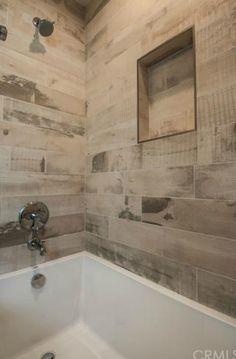 faux wood shower tile                                                                                                                                                      More