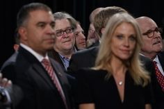 Why we're saying 'white nationalism' instead of 'alt-right.  Bannon, center left, back, campaign CEO for Republican presidential candidate Donald Trump, looks on as Trump speaks during a campaign rally on Election Day.
