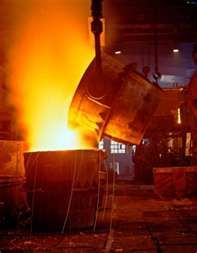 A pour in a steel mill ...