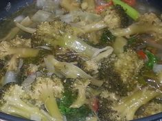 Broccoli and kale in lemon butter white wine sauce with tomatoes and onions