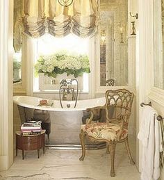 Beautiful. Love the mirrors, silver tub, balloon shade, french chair, etc.