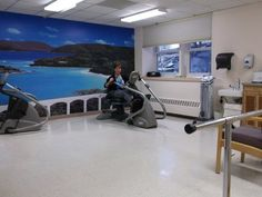 Ann Marie MacDougall, our Director of Rehab Services, demonstrating one of our NuStep recumbent crosstrainers.