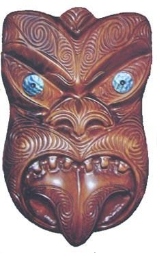 This New Zealand Maori Tiki Mask is a relatively large and very intricately carved Tiki Mask. Measuring long and wide, the Maori Mask features tattoo carving, traditional paua ( abalone) shell eyes, fiercesome teeth, and the protruding tongue.