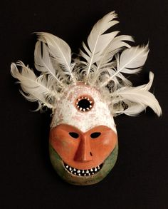 This mask represents the angalkut (shaman) and has a hole in the mask's surface representing the passages (or ice holes) though which the animals move in their journey toward the hunter.