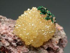 Minetite yellow crystals prism shaped ball with green Malachite on matrix / Tsumeb, Namibia