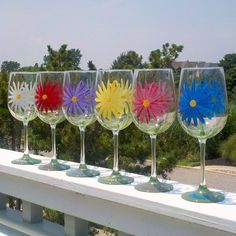 Daisy hand painted wine glasses by GlassesbyJoAnne on Etsy, $100.00