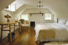 The master bedroom retains the small original fireplace at its far end.